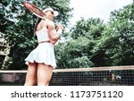 girl holding racket. sexy... | Shutterstock . vector #1173751120