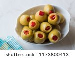 green olives stuffed with red... | Shutterstock . vector #1173800413