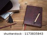 graduate cap  stack of books... | Shutterstock . vector #1173835843