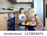 mother and son with a tray of... | Shutterstock . vector #1173856876
