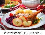 crusty christmas duck leg with... | Shutterstock . vector #1173857050