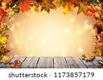 autumn background with falling... | Shutterstock . vector #1173857179