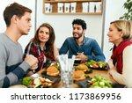people having dinner together... | Shutterstock . vector #1173869956