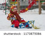 cute little child in winter... | Shutterstock . vector #1173875086