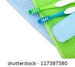 Toothbrushes and soap over towels. View from above - stock photo