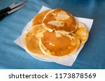plate with homemade pancakes... | Shutterstock . vector #1173878569