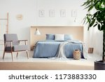 wooden patterned armchair next... | Shutterstock . vector #1173883330