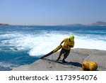 dock workers tie mooring ropes... | Shutterstock . vector #1173954076