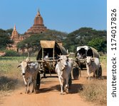 Small photo of Bagan. Myanmar. 01.26.13. Farmers on the way to market in bullock-drawn carts. Bagan in Myanmar (Burma).