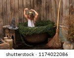 young witch flew on broom in... | Shutterstock . vector #1174022086