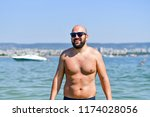 muscular athletic  beardedman... | Shutterstock . vector #1174028056