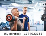 older man lifting weights ... | Shutterstock . vector #1174033153