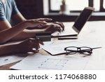 close up man hands using laptop ... | Shutterstock . vector #1174068880