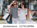 young women with shopping bags... | Shutterstock . vector #1174118986