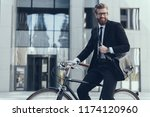young businessman looking in... | Shutterstock . vector #1174120960
