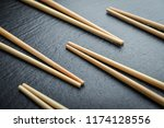 some bamboo chopsticks on black ... | Shutterstock . vector #1174128556