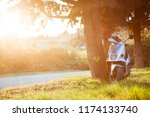 steel motor scooter is parked... | Shutterstock . vector #1174133740