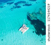 drone aerial view of catamaran... | Shutterstock . vector #1174144219