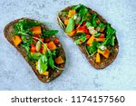 toast with pumpkin and arugula. ... | Shutterstock . vector #1174157560