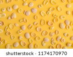 corn flakes pattern on yellow... | Shutterstock . vector #1174170970