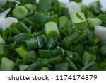 chopped young green onion ... | Shutterstock . vector #1174174879