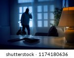 burglar or intruder inside of a ... | Shutterstock . vector #1174180636