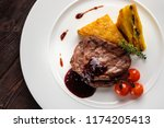 meat medallions with berry... | Shutterstock . vector #1174205413