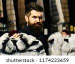 customer with beard chooses...   Shutterstock . vector #1174223659