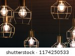 chandelier with hanging bulb... | Shutterstock . vector #1174250533