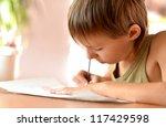 nice little boy at a desk... | Shutterstock . vector #117429598