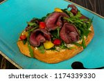 bruschetta with roastbeef and... | Shutterstock . vector #1174339330