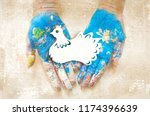 peace day the paper dove on the ... | Shutterstock . vector #1174396639