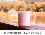 porcelain white cup on the... | Shutterstock . vector #1174397113