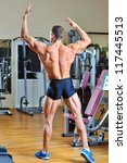 bodybuilder posing at gym  ... | Shutterstock . vector #117445513