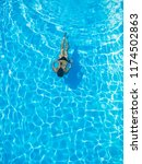 top view of a woman swimming in ... | Shutterstock . vector #1174502863