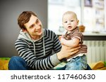 young father lifting his baby... | Shutterstock . vector #117460630