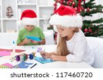Kids making christmas or seasonal greeting cards - stock photo