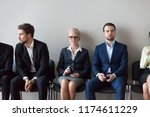 group of serious young and... | Shutterstock . vector #1174611229
