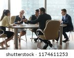multiracial group of workers... | Shutterstock . vector #1174611253
