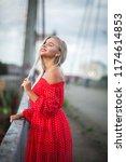 cheerful blonde model wearing... | Shutterstock . vector #1174614853