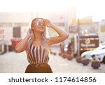 lifestyle outdoor portrait of... | Shutterstock . vector #1174614856