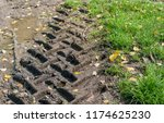 Closeup Of Tractor Tire Tracks...