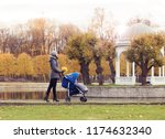 mother playing in park with her ... | Shutterstock . vector #1174632340