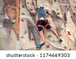 young man practicing rock... | Shutterstock . vector #1174669303