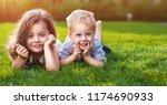 happy little girl and boy lying ... | Shutterstock . vector #1174690933