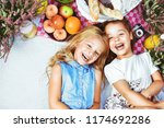 two cheerful little girls on a... | Shutterstock . vector #1174692286
