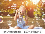 happy little girl in autumn... | Shutterstock . vector #1174698343