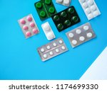different pills on blue... | Shutterstock . vector #1174699330