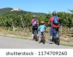 bicycle tour with the family | Shutterstock . vector #1174709260