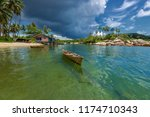 traditional boat with clean sea ... | Shutterstock . vector #1174710343
